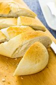 picture of baguette  - Sliced fresh French Baguette on the cutting board - JPG