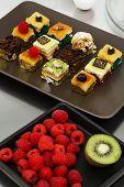 picture of petition  - Assortment of petit four gourmet dessert Sweet food and desserts - JPG