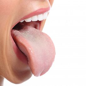 foto of sticking out tongue  - Close up of a woman mouth sticking tongue isolated on a white background - JPG