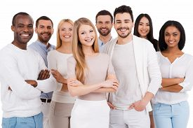 pic of diversity  - Group of positive and diverse people in smart casual wear looking at camera and smiling while standing against white background - JPG