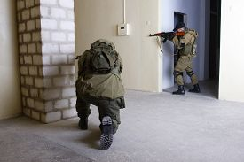 pic of ak-47  - insurgents with AK 47 ang RPD gun inside the building - JPG