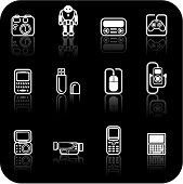 stock photo of gizmo  - A set of white gadget icons on black background - JPG