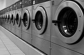 stock photo of washing machine  - industrial washing machines in a laundromat with a vanishing point - JPG