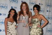 LOS ANGELES - JAN 5:  Kourtney, Khloe, Kim Kardashian arrives at 2011 People's Choice Awards at Nokia Theater at LA Live on January 5, 2011 in Los Angeles, CA