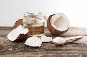 Half Of Coconut, Pieces Of Coconut, Coconut Flakes And Coconut Glaas Jar poster