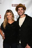 LOS ANGELES - FEB 20:  Amber Lancaster; Jayson Blair arrives at the 24 Hour Hollywood Rush at Ebell
