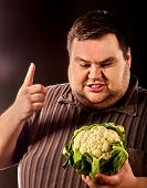 Diet fat man eating healthy food. Healthy breakfast with vegetables cauliflower for overweight perso poster