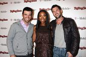 LOS ANGELES - FEB 26:  Tony Dovolani, Brandy Norwood and Maksim Chmerkovskiy arrive at the Rolling Stone Pre-Oscar Bash 2011 at W Hotel on February 26, 2011 in Hollywood, CA