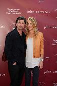 LOS ANGELES - MAR 13:  Patrick Dempsey, .Jill Fink Dempsey arriving at the John Varvatos 8th Annual
