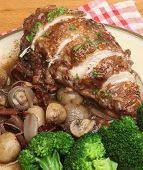 Coq au vin. Chicken casseroled in red wine with bacon shallots and mushrooms.