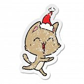 happy hand drawn distressed sticker cartoon of a cat meowing wearing santa hat poster