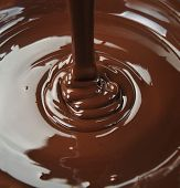 stock photo of irresistible  - lots of chocolate falling from above  - JPG