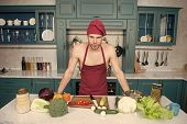 Attractive Chef Ready To Cook. Muscular Chef Posing In Kitchen. Cook Delicious Recipe. Sexy Macho Co poster