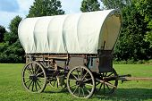stock photo of covered wagon  - Covered wagon with a beautiful landscape background - JPG