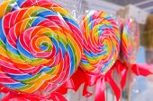 Rainbow Lollipop Swirl On Wooden Stick In Candy Store, Selective Focus.sweet Candy.candy Bar.lollipo poster