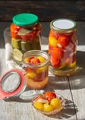 Fermented Preserved Vegetables In Jar On Wooden Table. Copyspace poster