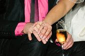 Bride and groom's hands with wedding ring