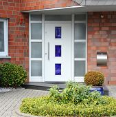 pic of front-entry  - Modern entry door with a front garden of the house  - JPG