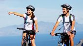 Happy carefree mountain bike couple cycling outdoors and leading a healthy lifestyle.
