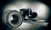 Lens & Film Strip On Dark Background