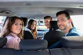 Smiling People Sitting Inside The Ride Sharing Car poster
