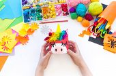 Child Makes A Hand-made Unicorn Out Of A Tin Can. Rainbow Hair poster
