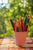 Color Pencils In The Iron Bucket. Pencils In A Stack. Colour Pencils poster