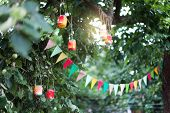 Garland Of Colorful Flags And Homemade Flashlights At Sunset In Summer Garden. Concept Of Celebratio poster