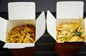 Two Carton Boxes With Hot Noodles. Chicken And Pork With Vegetables. Food To Go poster