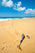 pic of artificial limb  - Couple resting on the beach - JPG