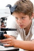 Close Up Portrait Of Boy With Microscope.