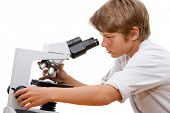 Young Student Looking Through Microscope.