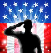 stock photo of soldier  - An American US military soldier from the armed forces in silhouette in uniform saluting in front of an American flag background of red white and blue stars and stripes - JPG