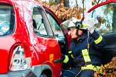 Accident - Fire brigade rescues accident Victim of a car, firefighter holds a drip for Infusion