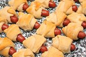 Pigs in the blanket - little sausages baked in bread