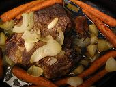 image of pot roast  - this is a beef roast with carrots and onions in a roaster - JPG