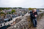Two Boys Listening Audio Guide And Discussing At Amboise Castle In Loire Valley