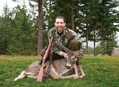 pic of deer meat  - Happy hunter after a successful deer hunting expedition - JPG