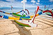 image of dua  - Traditional fishing boats on a beach in Nusa Dua on Bali - JPG