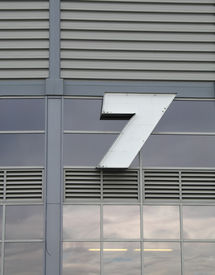 pic of number 7  - a sign 7 on a large building - JPG