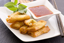 foto of lumpia  - spring rolls with sauce - JPG
