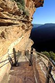 stock photo of breathtaking  - Awe inspiring National Pass trail clings impossibly to the sheer cliff face Blue Mountains Australia - JPG