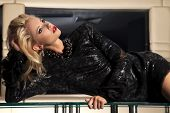 portrait of a beautiful young adult sensuality blonde woman in black dress