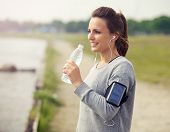 Female Runner Drinking Bottled Water