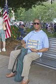 Man Holds Sign About Jobs At Moral Monday Rally