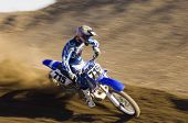 picture of motocross  - Young motocross racer riding motorcycle on dirt track - JPG