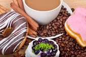 Coffee Cup With Coffee Beans Ans Sweet Cake On A Wooden Background