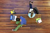stock photo of bench  - Top view of male and female university students studying - JPG