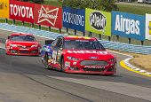 WATKINS GLEN, NY - AUG 11, 2013:  Kyle Busch (18) wins the Cheez-It 355 at The Glen race at the Watk