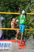 KAPOSVAR, HUNGARY - AUGUST 4: Balint Magyar (L) in action at a ROAK Viragfurdo Kupa beach volleyball competition, August 4, 2013 in Kaposvar, Hungary.